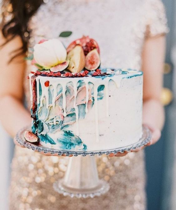 an artistic watercolor wedding cake topped with fresh fruit for a bold late summer or fall wedding