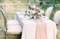 15 a blush silk table runner and matching candles for adding elegance to the table
