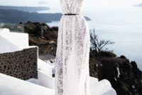 15 a boho lace wedding gown accented with a thin black belt for a more modern feel