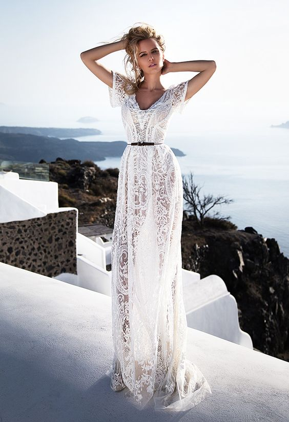A Boho Lace Wedding Gown Accented With Thin Black Belt For More Modern Feel