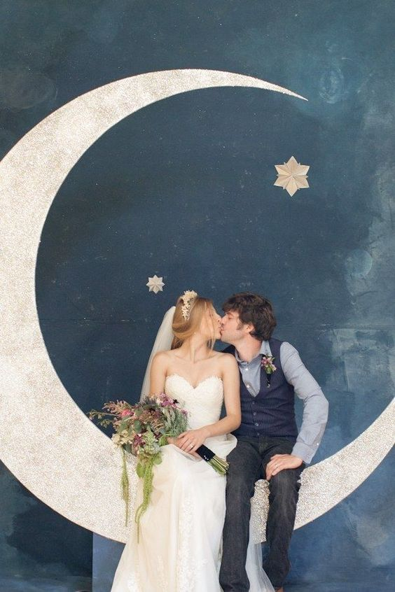 a giant crescent moon is a stunning photo backdrop that brings a cute vintage feel
