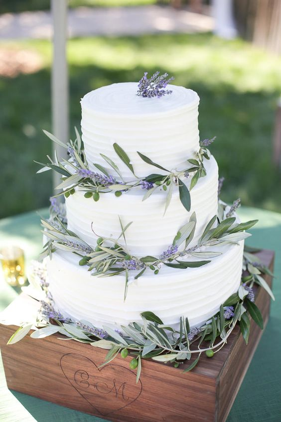 a textural buttercream wedding cake decorated with lavender and greenery for a rustic wedding