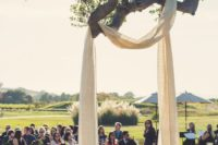 15 some light fabric hung on a tree branch as a wedding arch is a creative idea
