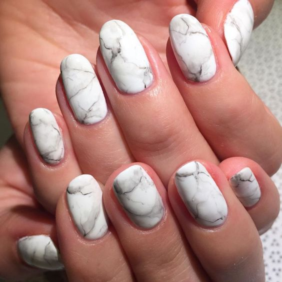 white marble manicure is a trendy and chic idea for any bride, and they fit most of looks