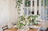 16 a blush table runner and lush floral centerpieces are all you need to create a chic spring tablescape