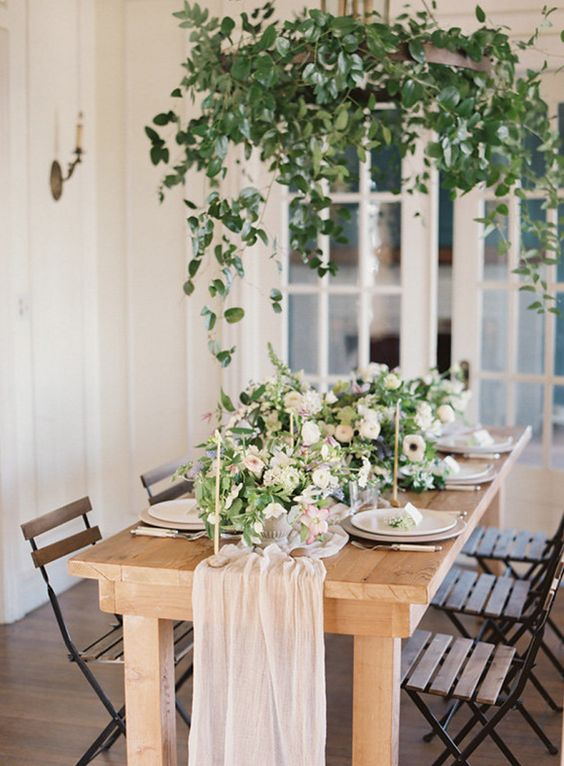a blush table runner and lush floral centerpieces are all you need to create a chic spring tablescape