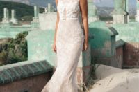 16 a delicate lace sheath wedding dress with cap sleeves, an illusion neckline and a thin white leather belt