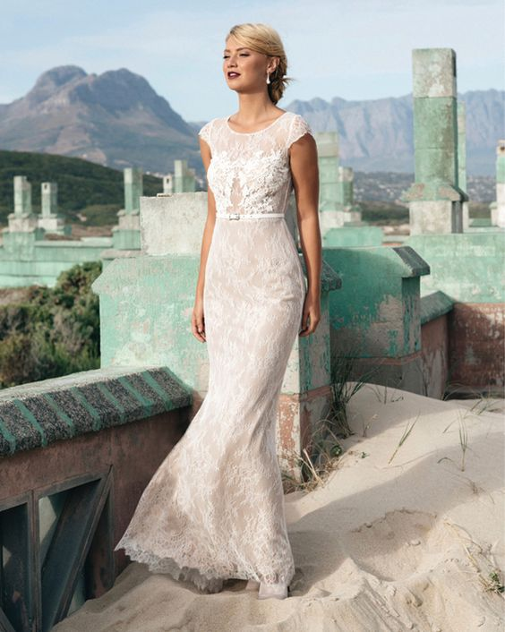 a delicate lace sheath wedding dress with cap sleeves, an illusion neckline and a thin white leather belt
