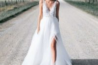 16 a gorgeous A-line wedding gown with thick illusion straps, a lace bodice and a layered skirt with a front slit