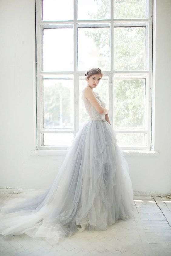 a light blue ballgown with a lace bodice, no sleeves and a layered tulle full skirt with a train