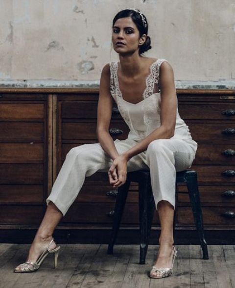 a plain bridal jumpsuit with cropped pants and a strapless top plus a lace overtop and metallic shoes