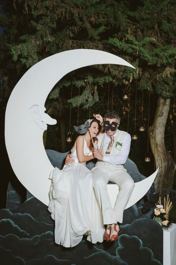 a vintage crescent moon wedding backdrop with clouds and a night sky for a wedding photo booth