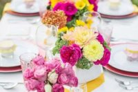 17 a bold yellow and white chevron table runner plus bright floral centerpieces for those who love bold colors