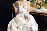 17 a pastel floral print wedding dress with a V-neckline, straps and an A-line silhouette for a garden wedding