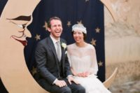 17 a vintage crescent moon wedding photo booth backdrop, a curtain to imitate a night sky with stars