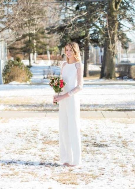 a white fitting bridal jumpsuit with long lace sleeves for a stylish and modenr look