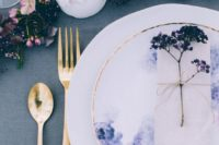 17 a woodland wedding tablescape done in pink and purple hues with some wildflowers