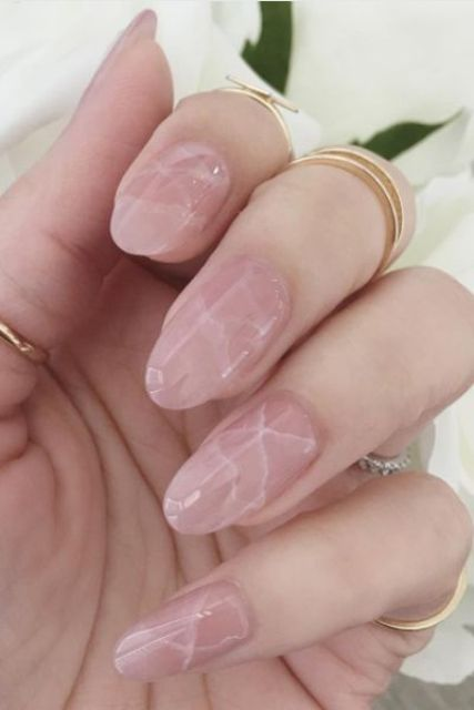 pink marble nails is a trendy and chic touch for a spring bridal look