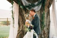 17 some air fabric, a lush greenery arch on the branches for a cool natural look