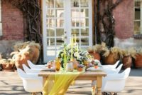 18 a bold yellow airy table runner and matching candles for those who want to add a touch of color