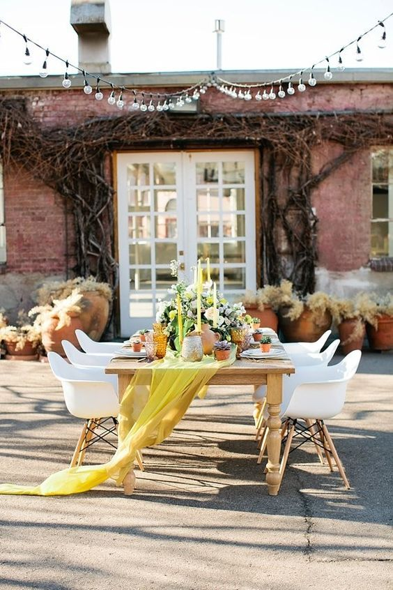 a bold yellow airy table runner and matching candles for those who want to add a touch of color