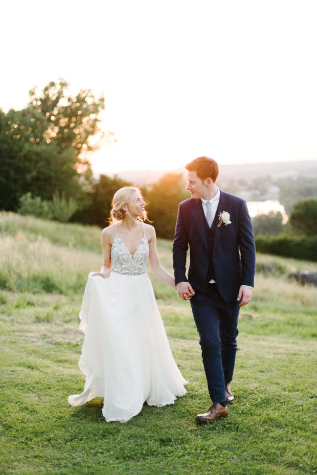 a spaghetti strap A line wedding dress with a heavily embellished bodice and straps and a flowy skirt for a contrasting look