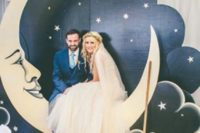 18 a vintage styled crescent moon with a night sky and stars as a wedding photo booth backdrop