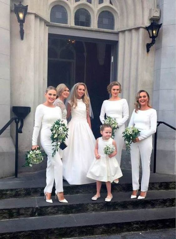 modest white jumpsuits with long sleeves and white shoes for a trendy white bridal party look