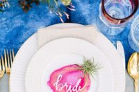 19 a bold blue watercolor table runner, a bright pink floral centerpiece and an agate slice card