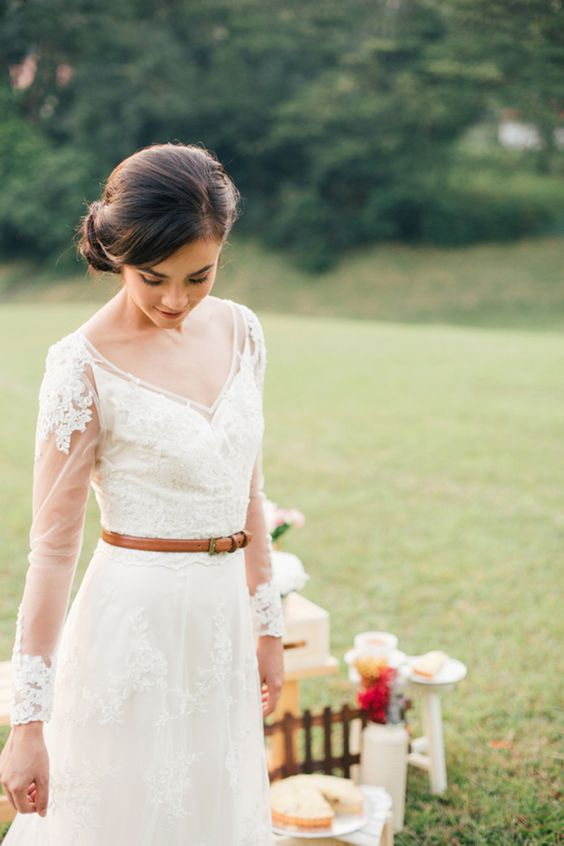 a modest and cute wedding dress with illusion sleeves and an amber leather belt for a rustic touch