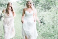19 a spaghetti strap wedding gown with a lace bodice, a V-neckline and an A-line skirt