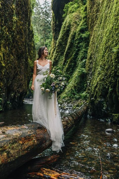 a woodland bridal portrait over the river looks really cool and amazing