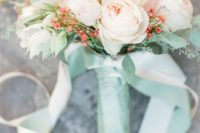 20 a peachy pink and ivory wedding bouquet with a mint wrap and ribbons