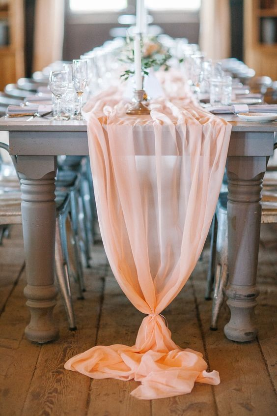 a peachy pink ethereal table runner going down to the floor is a chic idea and looks romantic