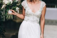 20 a romantic beaded Anna Campbell wedding dress with a flattering neckline and cap sleeves