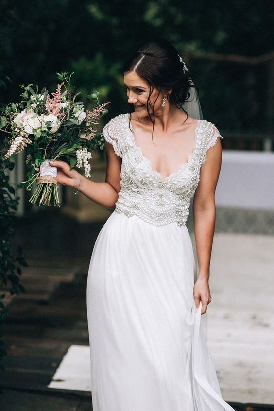 a romantic beaded Anna Campbell wedding dress with a flattering neckline and cap sleeves