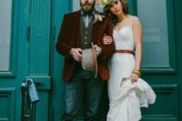 20 a spaghetti strap sheath wedding dress accented with an amber leather belt for a gorgeous look