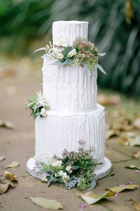 a textural white wedding cake decorated with succulents, herbs, greenery and little blooms for a modern wedding