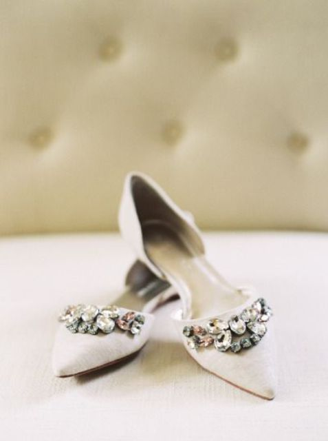 pointed white flats with heavy embellishments is a great way to add a bold touch