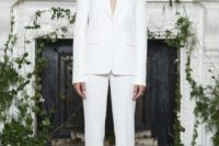 21 a classic creamy pantsuit with a plunging neckline and beaded shoes for a timeless and sexy look