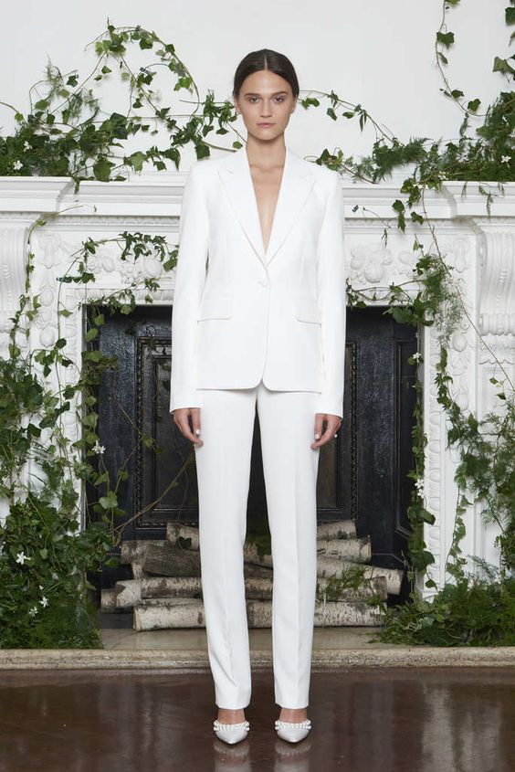 a classic creamy pantsuit with a plunging neckline and beaded shoes for a timeless and sexy look