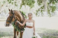 21 a strapless A-line bridal dress with a wide amber leather belt for a rustic and equastrian feel