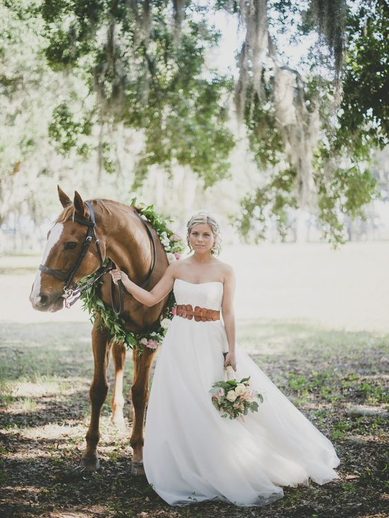 a strapless A line bridal dress with a wide amber leather belt for a rustic and equastrian feel