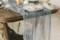 21 an ethereal dusty blue wedding table runner adds charm and beauty to the table setting