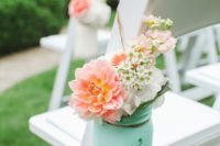22 a ceremony space chair with a mint jar and peachy pink flowers in it