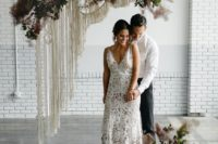 22 a semi sheer boho lace A-line wedding dress with a train and a deep V-neckline