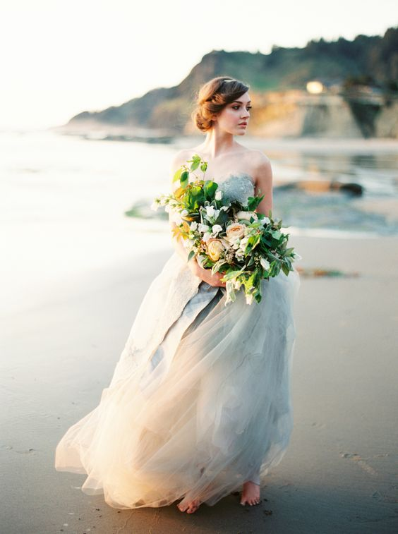 a strapless light blue grey wedding dress with a full tulle skirt and a lace bodice for a coastal bride