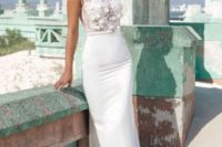 22 a stunning sheath wedding dress with an pplique bodice and a thin white leather belt that separates the sleek skirt from it