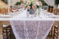 22 a white lace table runner is great for rustic, vintage and shabby chic weddings, and you can easily DIY it