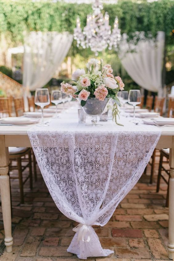 a white lace table runner is great for rustic, vintage and shabby chic weddings, and you can easily DIY it